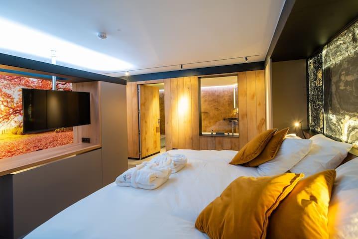 Suite de luxe avec terrasse et jacuzzis privatifs