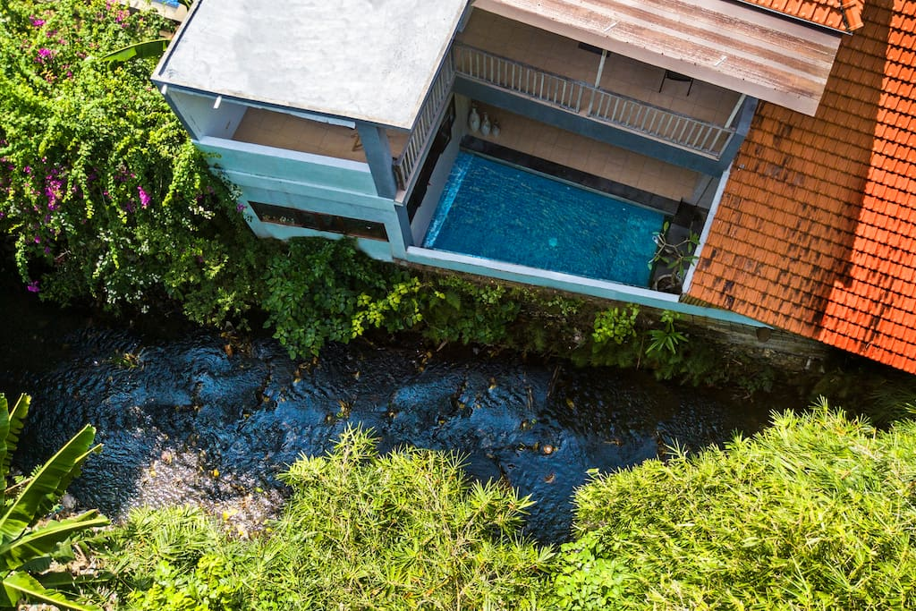 Aerial view villa and river and rain forest
