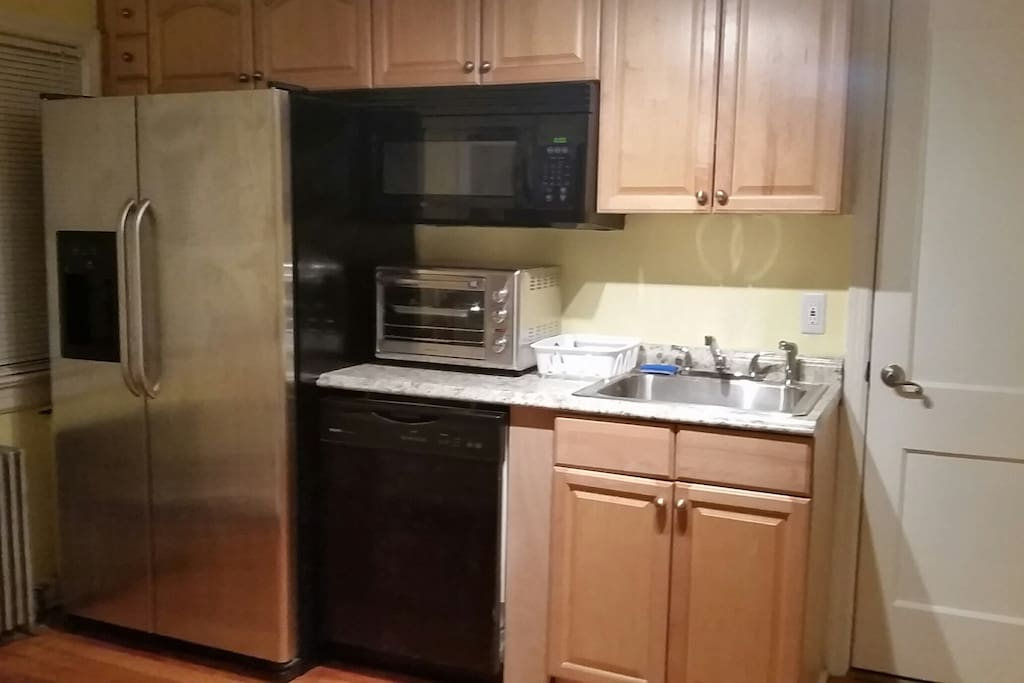 Kitchen:refrigerator, microwave oven, dish washer, convection oven, sink.