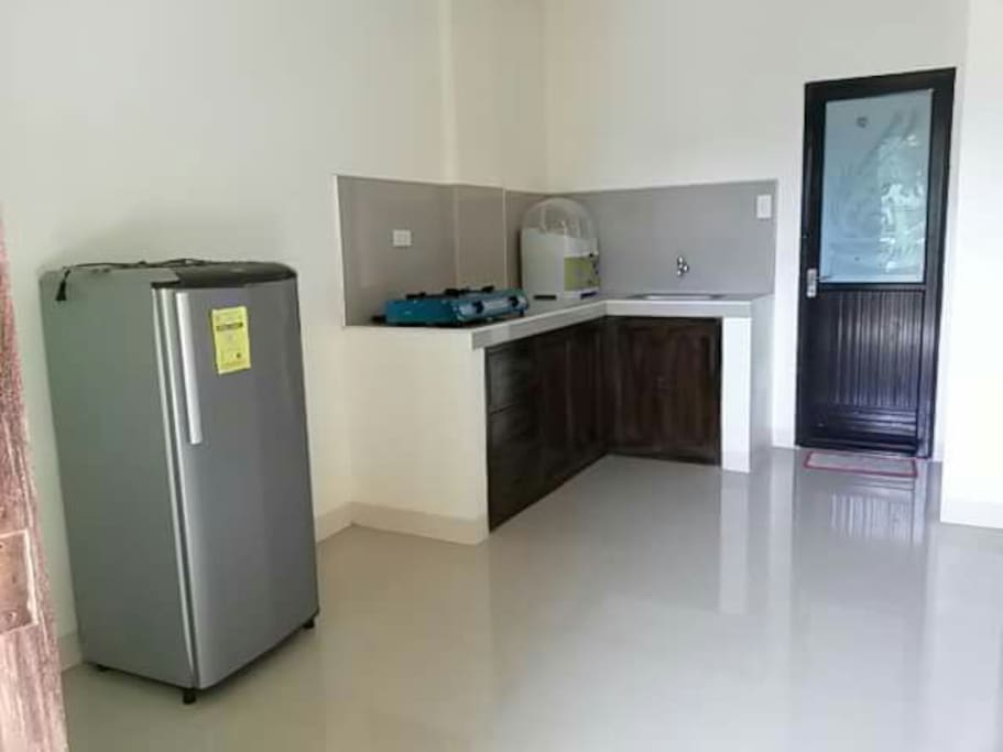 kitchen is with gas stove and refrigerator