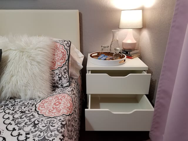 There's plenty of room for storage in both night stands.
