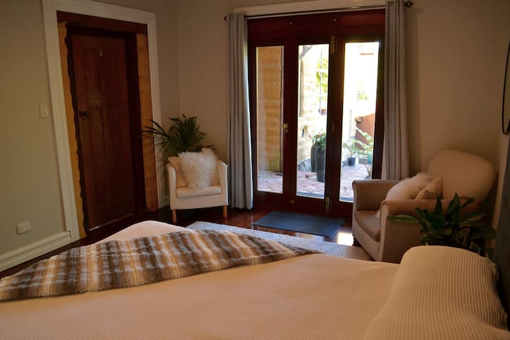 Double bedroom with door leading out to private patio