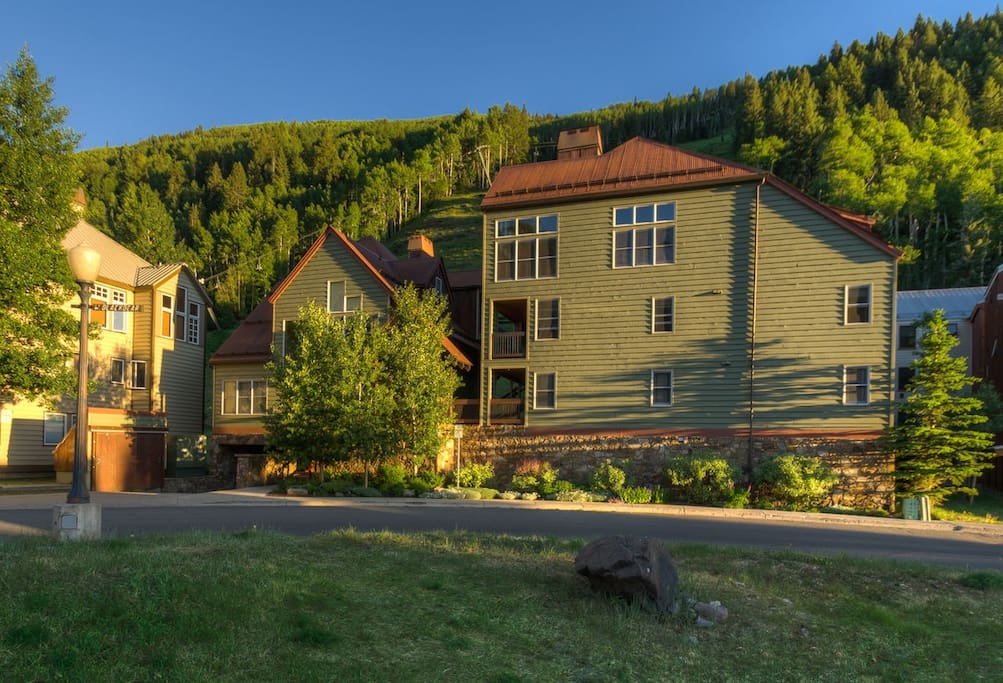 Exterior of Etta Place with ski runs behind it