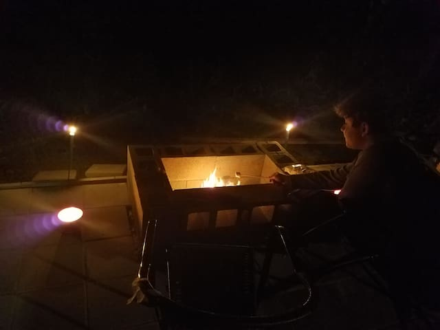 My son roasting marshmallows in the outdoor firepit just a few yards from the river.  Listening to both a crackling fire and a river flowing is heaven.