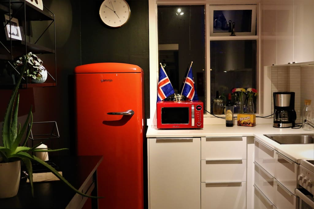 Beautiful kitchen with stove, oven, microwave, coffee maker, toaster, kettle, fridge and dishwasher.