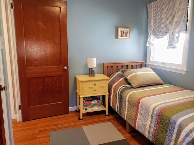 The second bedroom has two twin beds topped with cheery quilts.