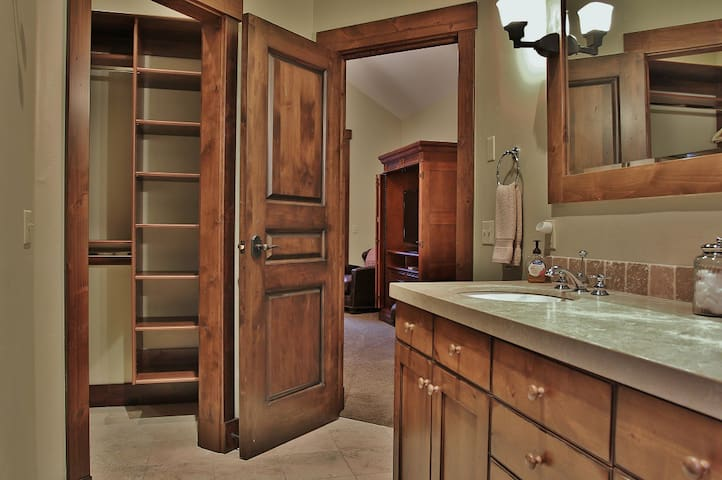 Large private bathroom 1 in main level master bedroom with shower, jacuzzi bath, and dual sinks