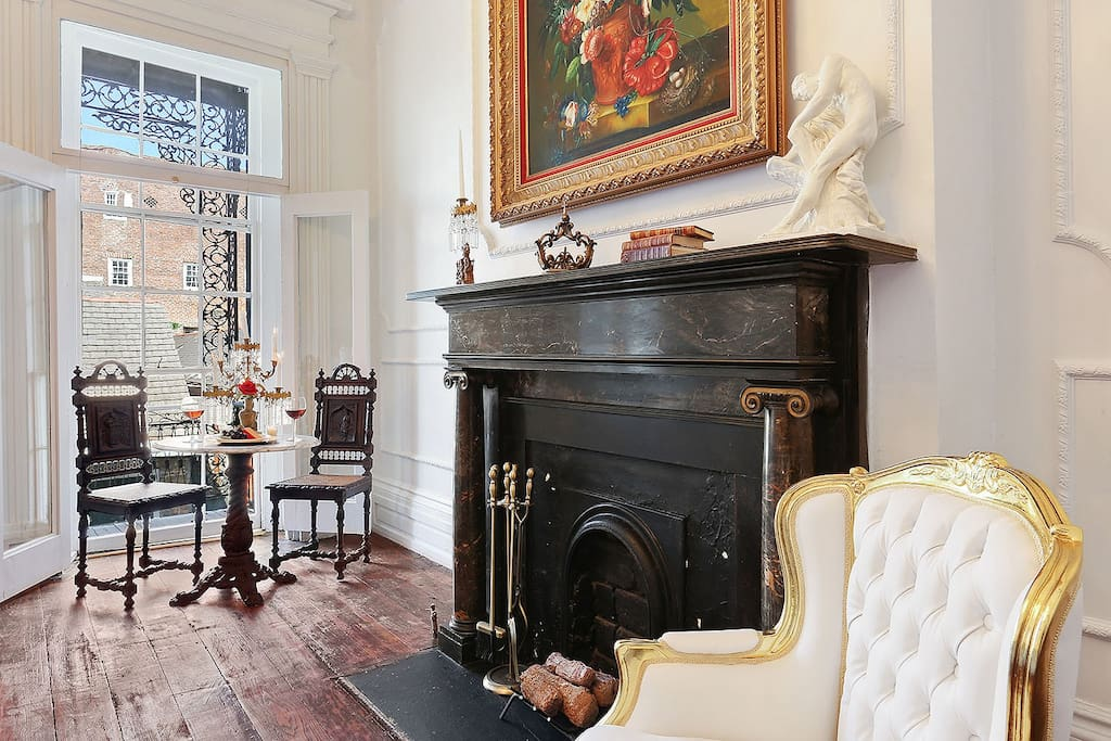 The original 1820s black shoreham marble fireplace is the central focus of this cozy and elegant suite