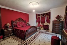 King Bed large Bedroom with a private toilet and balcony overlooking the woods, sea, and the village (angle1)