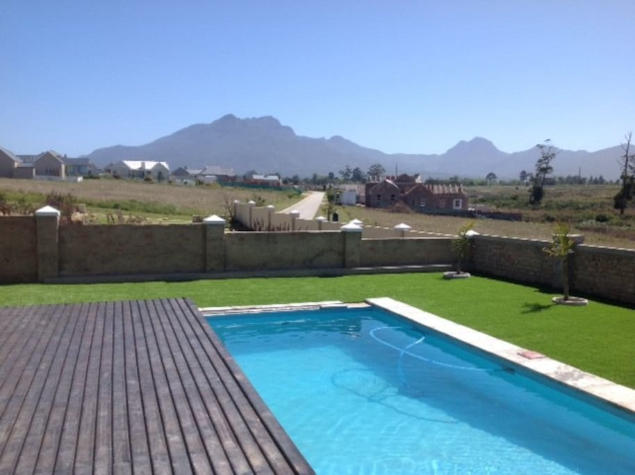 Swimming pool with sliding deck