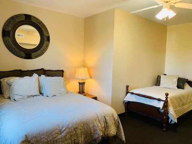 Bedroom 1 with queen and twin beds as well as flat screen TV, WiFi and walk-in closet.