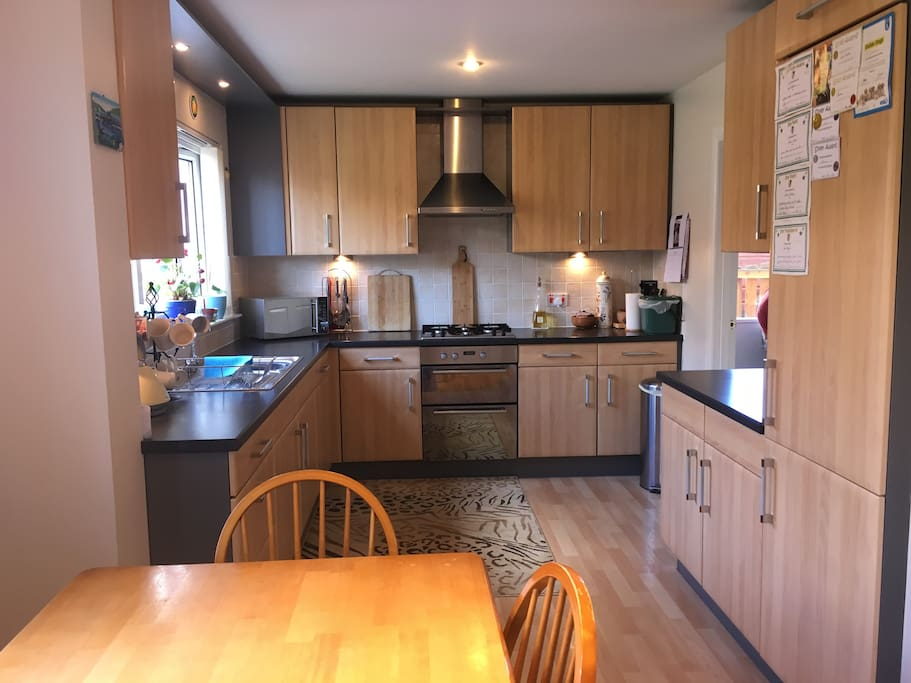 Kitchen diner with table seating for 6, oven, microwave, fridge, freezer and adjoining utility room with washing machine and dryer