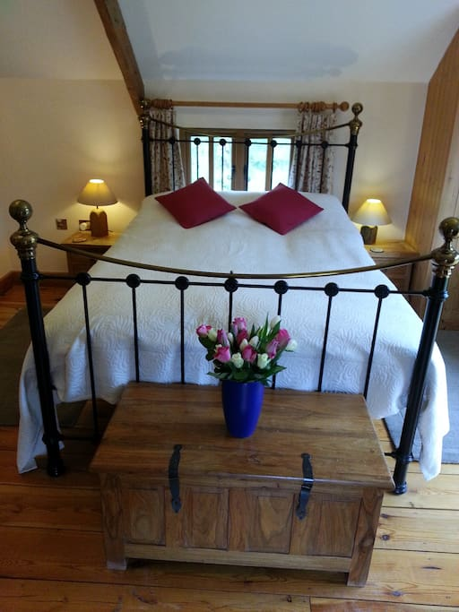 kingsize bed with pure organic fairtrade bedlinen throughout the house