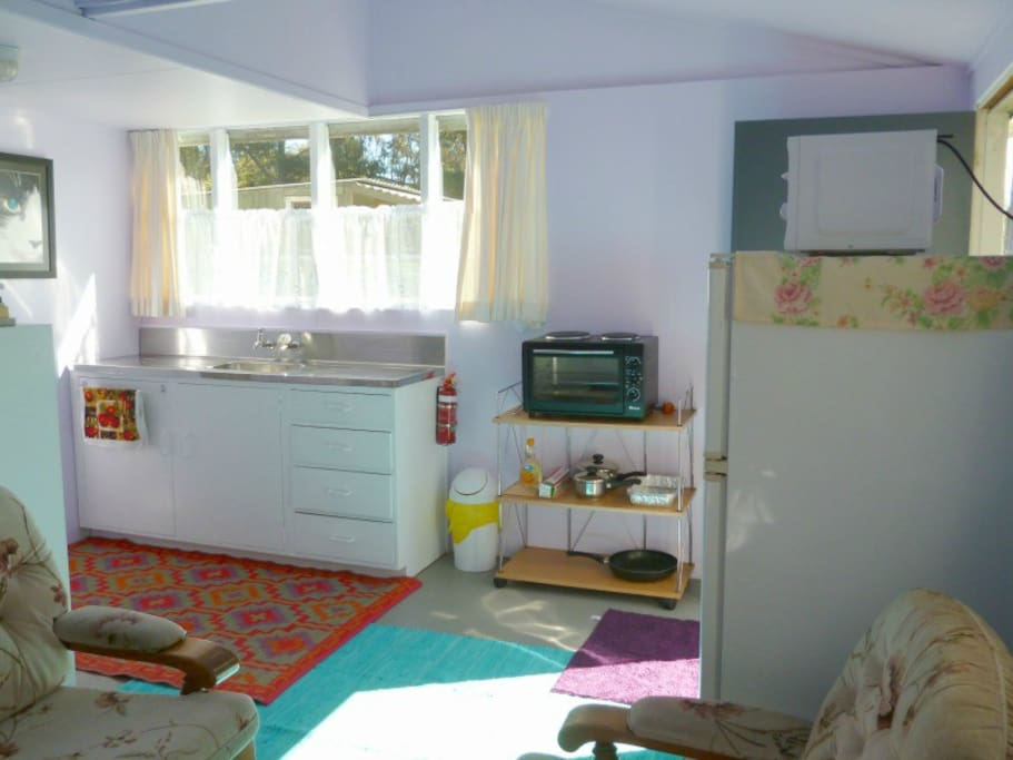 Kitchen area. Entrance door on the right.