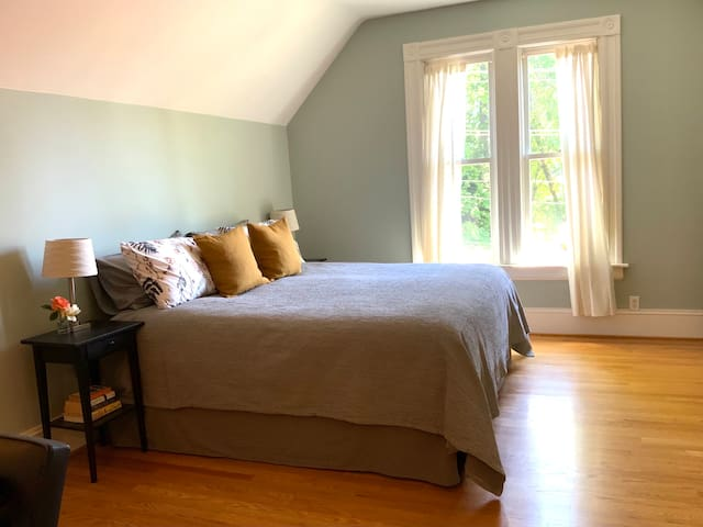 Sunny east-facing bedroom with treetop views