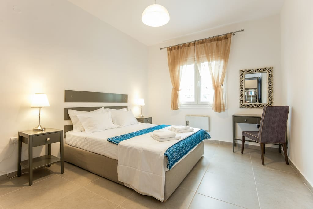 the main bedroom, with double bed and working table