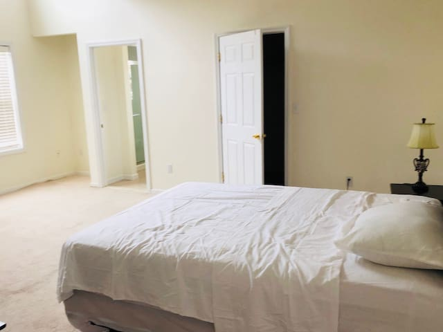 Master bedroom with full private bathroom , walk in closet ,steps to loft and another full bathroom plus a balcony.