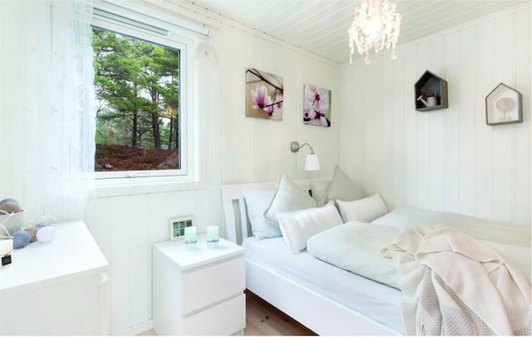 Third bedroom with double bed and chandelier.  Forest view.
