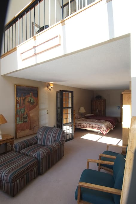 Sitting area and twin beds on lower floor
