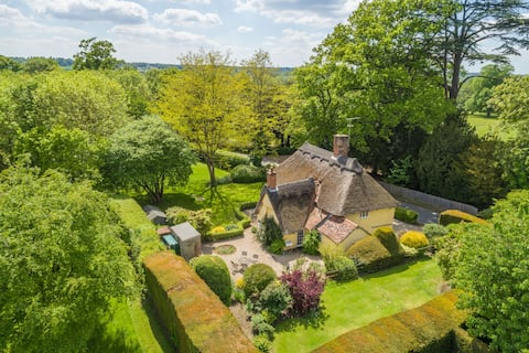 16th Century thatched cottage in 15 acre private park