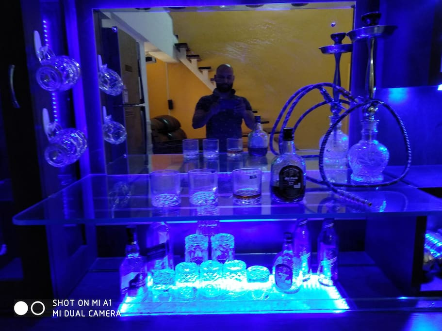 lot of glasses and hookah in bar