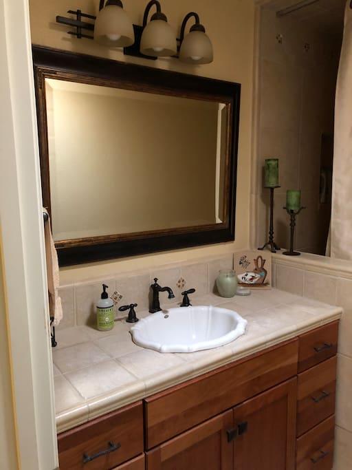 Full bathroom with shower/bathtub.