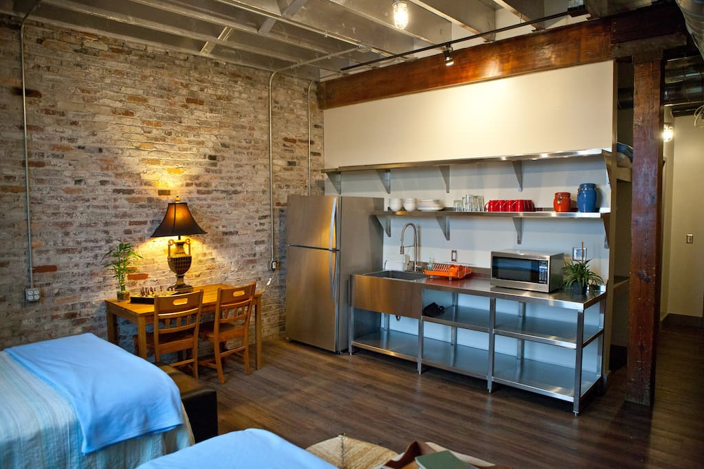 The studio has a kitchenette with fridge, coffee maker, microwave, dishware, and tea kettle!