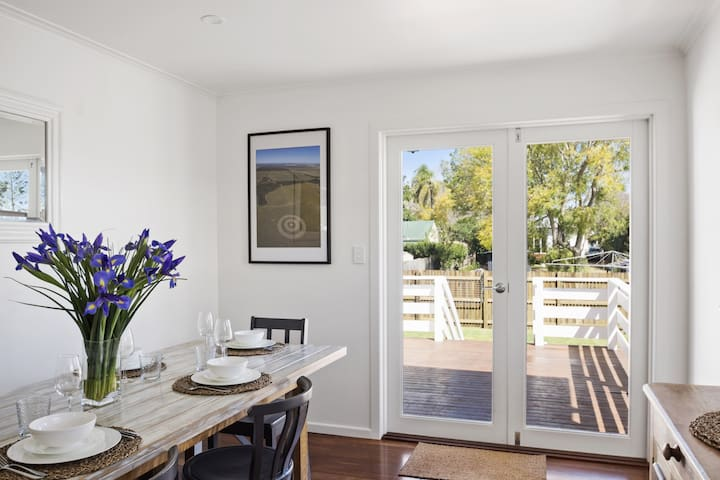 Dining room leading to deck and garden