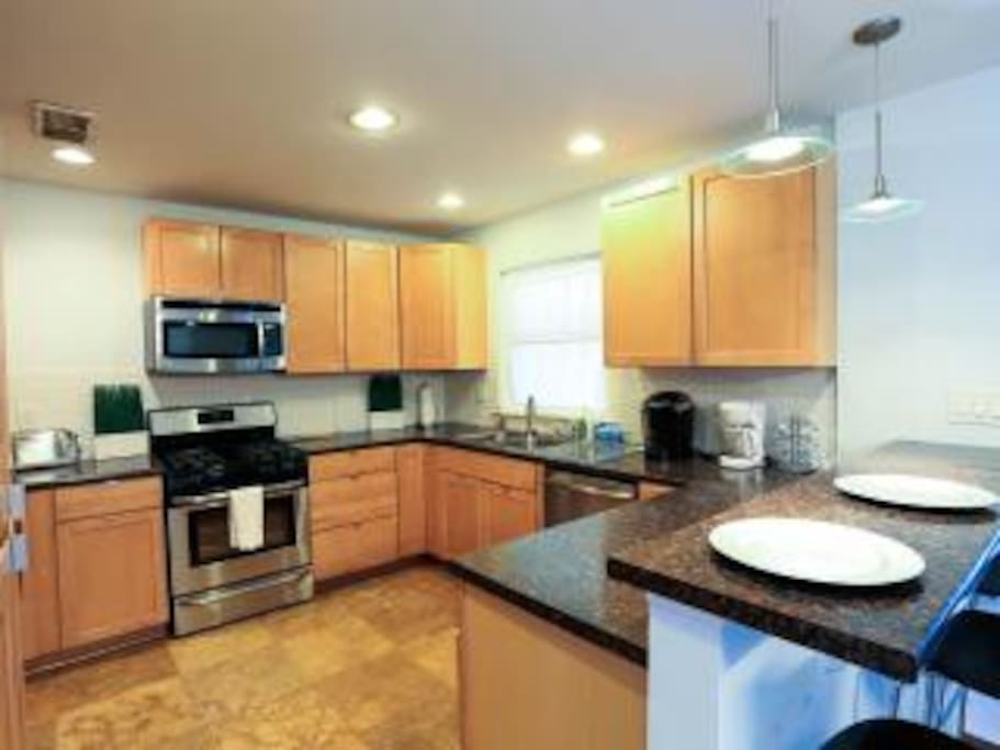 Kitchen small appliances include toaster and coffee maker.