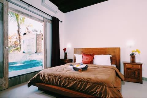 Villa Suari , vista para a piscina quarto 1
