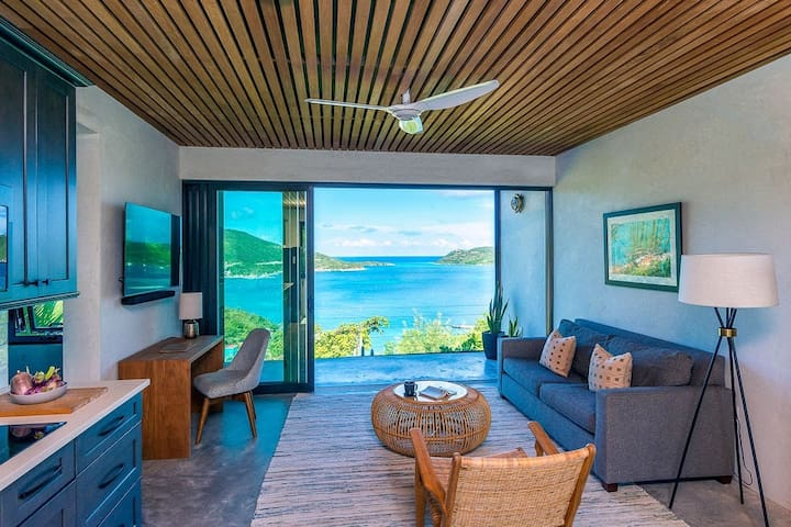 Living room with views of the Caribbean Sea, North Sound & Moskito Island