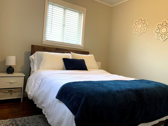 Full size bed with memory foam mattress, spacious closet with storage
