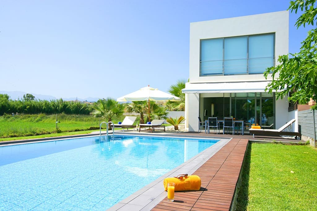Sunny day in Blue Sea Villa's large swimming pool