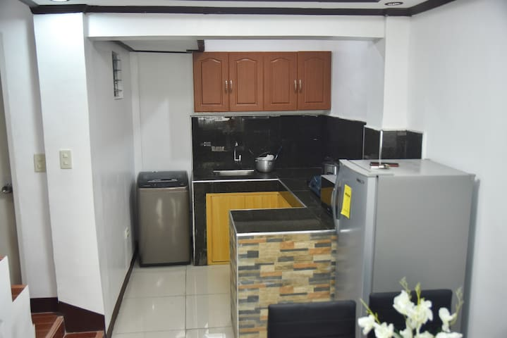 The house kitchen where you can enjoy cooking. Its equipt with Refrigerator, Microwave oven, Gas Stove, Electric Kettle,  Rice Cooker, Cooking basics - Pots and Pans, Diningware, glasses, mugs, spoons, and forks,  and cabinets.