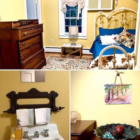 The Creek Side Yellow Bedroom with original boarding room sink