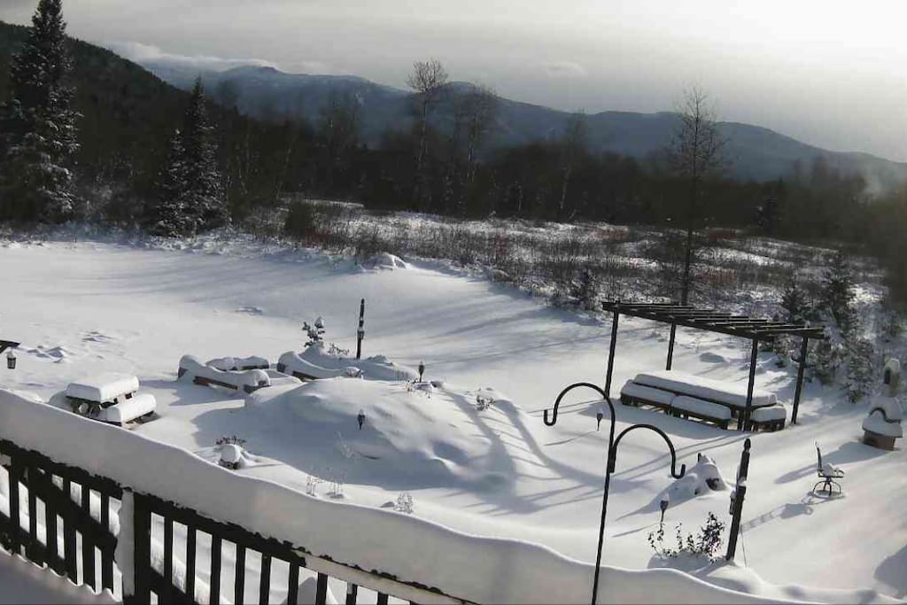 Winter view of the front yard (ski slopes are on the right, off view, Mt Washington to the left)