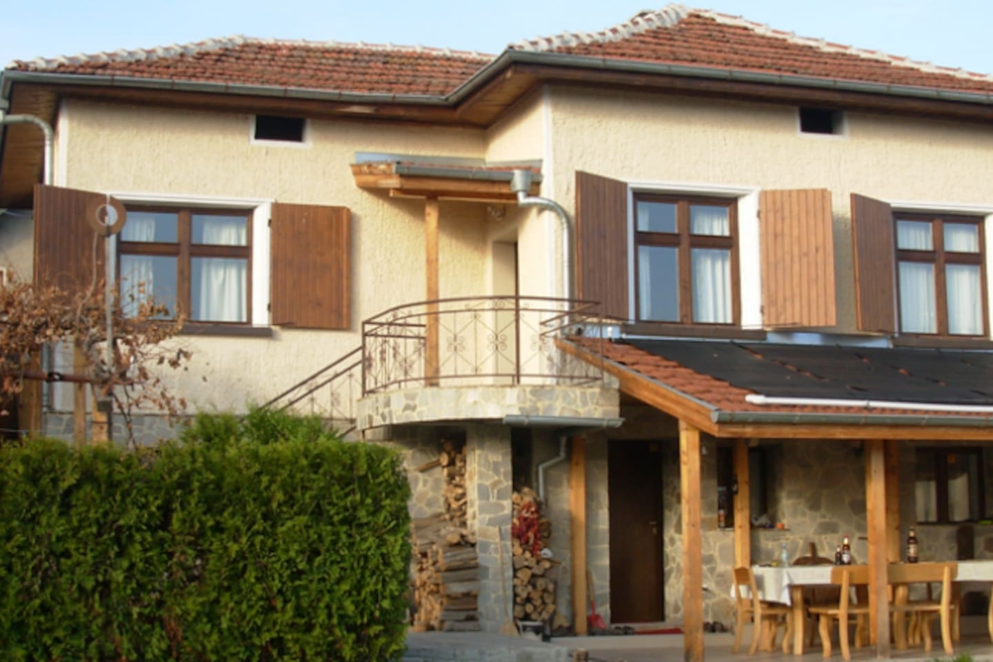 Typical Bulgarian house with small living and 3 sleeping rooms. Big outside terrace with table for 12 with kitchen outdoor.