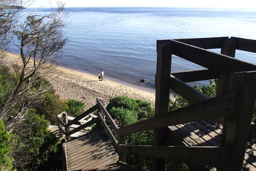 Beach access is by stairs from clifftop