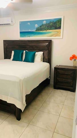 Nestle comfortably on this King sized bed with an orthopedic pillow top mattress.  This bedroom is appropriately designed with an ensuite bathroom.