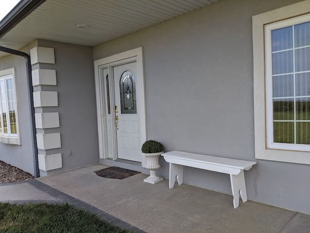 Welcome! Entry door is 32 inches wide with 1 six inch step. There are  5  soffit lights above walk & entry door. Digital keyless door locks with your customized code - so your group can come & go with ease.