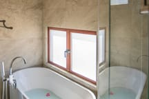 An extra large (Italy made) Rain shower and bathtub is available in the Master Bedroom