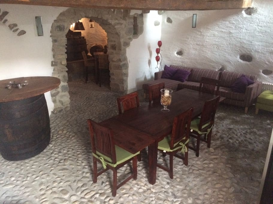 Wine cave with seating and dining area, where we host your welcome apero, first floor