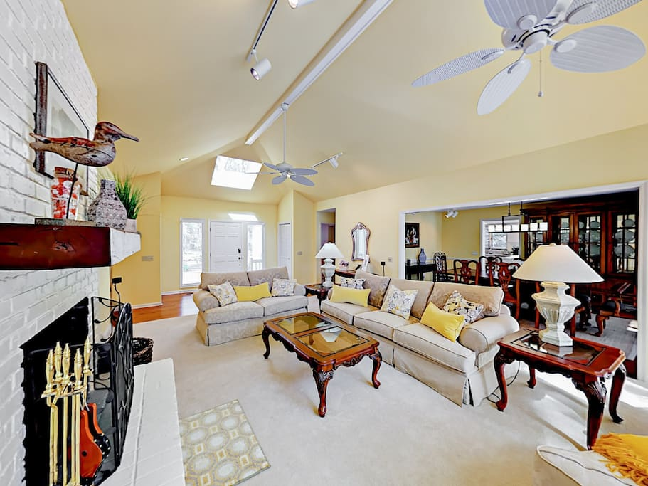 Plenty of seating in the living room with a couch, love seat, and armchair.