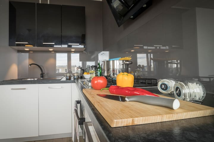 Very functional kitchen is a great place for preparing meals together.