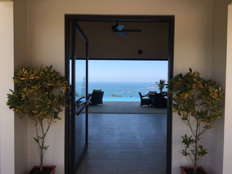 As you walk thru the front door, you see the ocean.