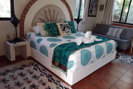 King bed with Otomi and Chiapian textiles