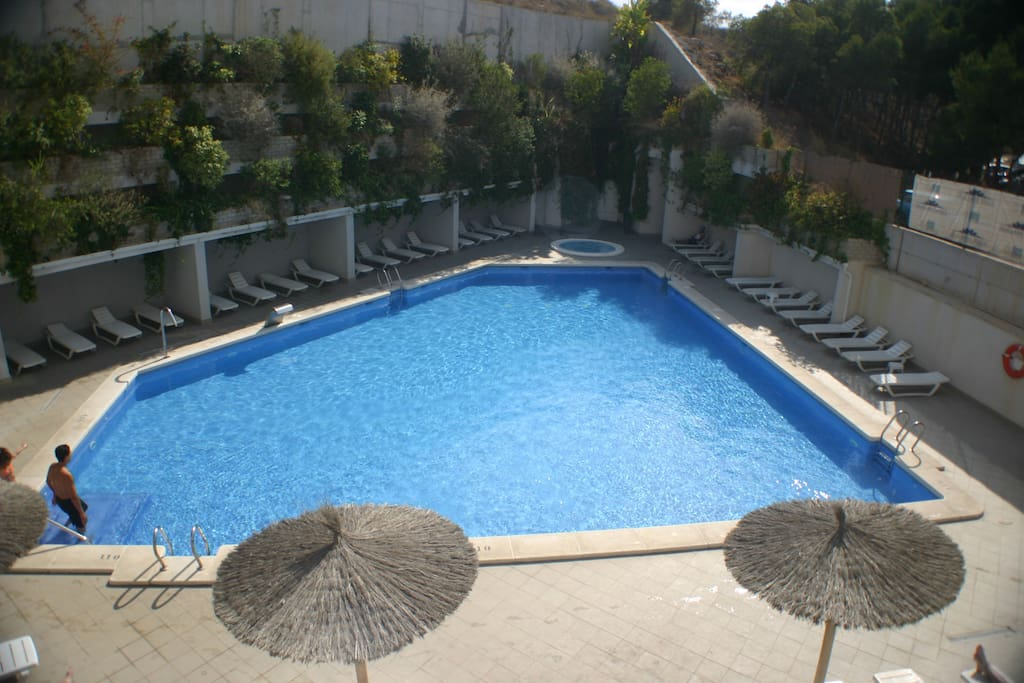View of swimming pool from an apartment balcony