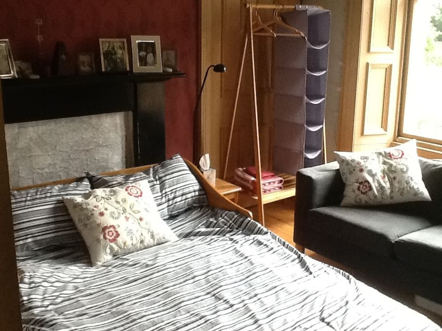 Sitting room set up as a bedroom with sofa bed & folding wardrobe & still plenty of space to sit!