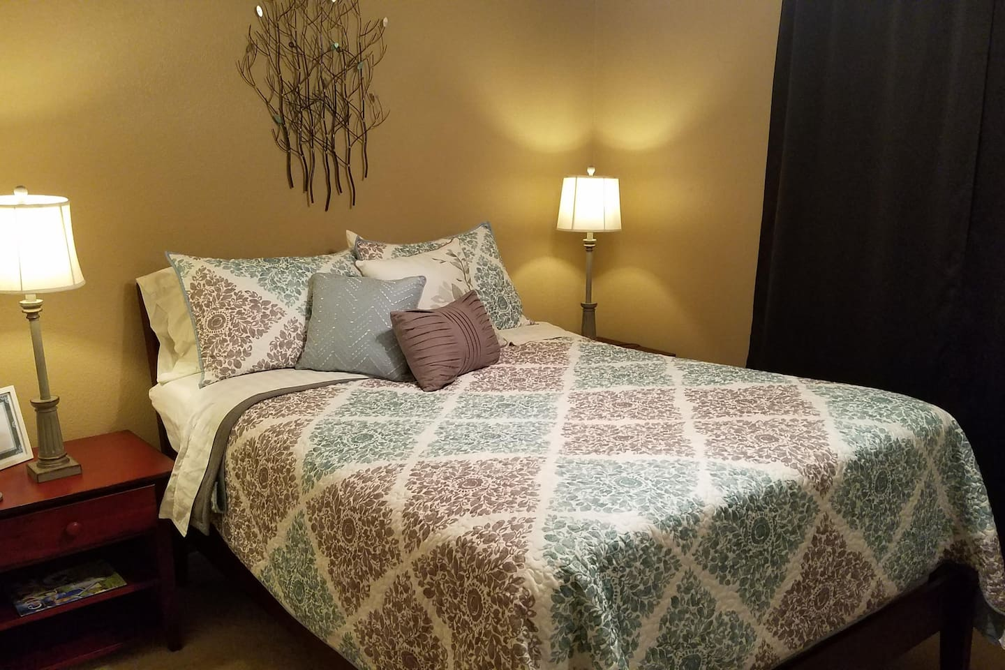 """Comfortable bed with 3"""" foam topper. Blackout curtains"""