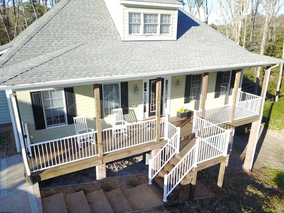 Front of home with porch to enjoy morning coffee or evening wine